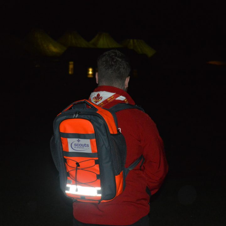 In use by the Scouts, showing the reflective strip of the bag
